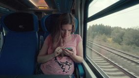 Pregnancy Woman Working with Smartphone on a Train stock footage