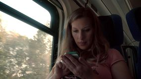 Pregnancy Woman Working with Smartphone on a Train. Pregnancy Woman Working with Smartphone and Laptop Computer on a Train stock video