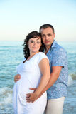 Pregnancy. Young loving couple on the beach. Royalty Free Stock Photos
