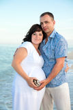 Pregnancy. Young loving couple on the beach. Royalty Free Stock Photography