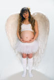 Pregnant angelic woman on white background Royalty Free Stock Photo