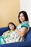 Pregnant Asian mother and her daughter Stock Photo