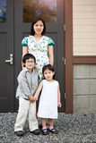 Pregnant Asian mother and her kids Royalty Free Stock Image