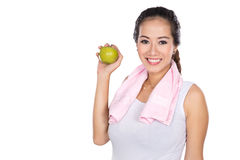 Pregnant asian woman holding an apple, smiling to the camera Royalty Free Stock Photos