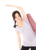 Pregnant asian woman isolated on white stretching Stock Photo