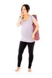 Pregnant asian woman isolated on white talking Stock Photo