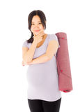 Pregnant asian woman isolated on white thinking Royalty Free Stock Photo