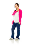 Pregnant asian woman isolated on white thinking Stock Photography