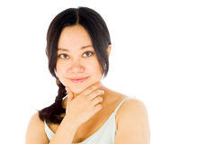 Pregnant asian woman isolated on white thinking Royalty Free Stock Photography