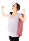 Pregnant asian woman isolated on white victory Royalty Free Stock Image
