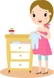 Pregnant with baby clothes Royalty Free Stock Photos