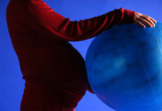 Pregnant with ball. Special excercise for pregnant women Royalty Free Stock Images