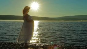 Pregnant on the beach meets the dawn. stock footage