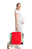 Pregnant beautiful woman with bags Stock Photo