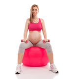 Pregnant beautiful woman exercise with ball and dumbbells Royalty Free Stock Image