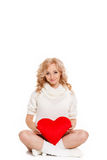 Pregnant beautiful woman holding red heart pillow in her hands isolated on white background Stock Photos