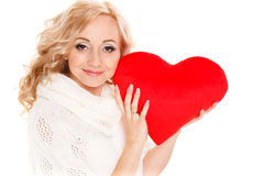 Pregnant beautiful woman holding red heart pillow in her hands isolated on white background Stock Photo