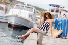 Pregnant beautiful woman on the pier at the sea Royalty Free Stock Photos