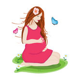 Pregnant. Beautiful young  and Happy  pregnant woman in pink dress prepared to be mother Royalty Free Stock Photography