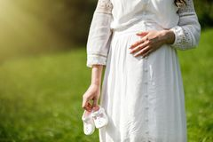 Young happy pregnant woman relaxing in nature. Close up of pregn stock image