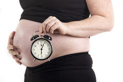 Pregnant belly clock Stock Photo