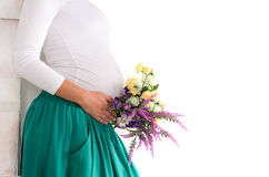 pregnant belly Close-up of flowers Stock Images