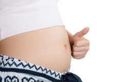 Pregnant Belly with fingers symbol Stock Photo