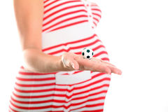Pregnant Belly and Football Ball Stock Images