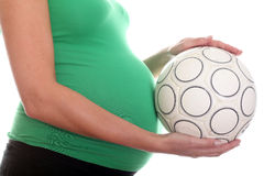 Pregnant Belly and Football Ball Stock Photography