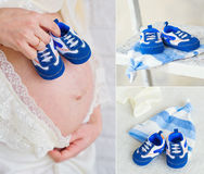 Pregnant belly with newborn baby booties Royalty Free Stock Photos