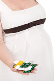 Pregnant belly with pills Stock Photos