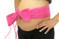 Pregnant belly with pink ribbon Royalty Free Stock Photography