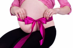 Pregnant belly with ribbon. Pregnant belly with pink ribbon Royalty Free Stock Image