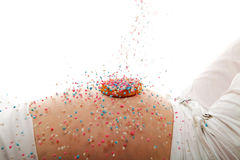 Pregnant belly with rusk and falling colorful mice Stock Photos