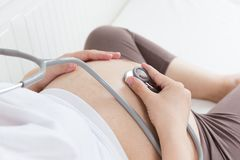 Pregnant belly with stethoscope Stock Photography