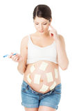 Pregnant belly and sticker notes, woman planning rasks, reminder Stock Photo