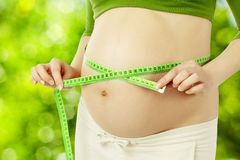 Pregnant belly, woman measure stomach. Prenatal health care