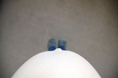 Pregnant belly woman, top view from above. Self shoot. Expecting baby birth in third trimester for being mother. Prenatal period Royalty Free Stock Photos
