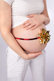 Pregnant Belly wth Ribbon Royalty Free Stock Photo