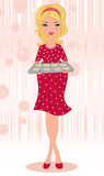 Pregnant blond holding freshly baked gingerbread c Royalty Free Stock Photo