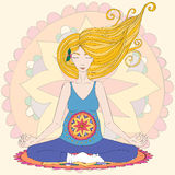 Pregnant blond woman practicing lotus asana in meditation. Royalty Free Stock Photos