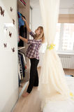 Pregnant blonde near wardrobe Royalty Free Stock Photos