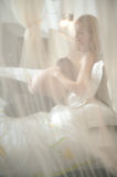 Pregnant blonde resting in bed Royalty Free Stock Images