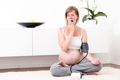 Pregnant blonde woman in her home. Stock Image