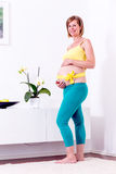 Pregnant blonde woman in her home. royalty free stock photos