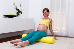 Pregnant blonde woman in her home. Stock Images