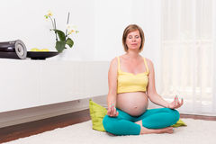 Pregnant blonde woman in the modern home. Stock Image