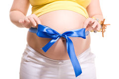 Pregnant with blue stripe and bowknot on white Stock Photo