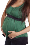 Pregnant body in green Stock Image