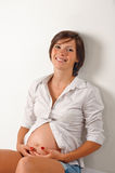 Pregnant brunette Royalty Free Stock Photos